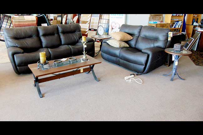 For a Classy and Modern Style in Your Living Room, Dark Leather, Wood, and Cast Iron are a Great Combination